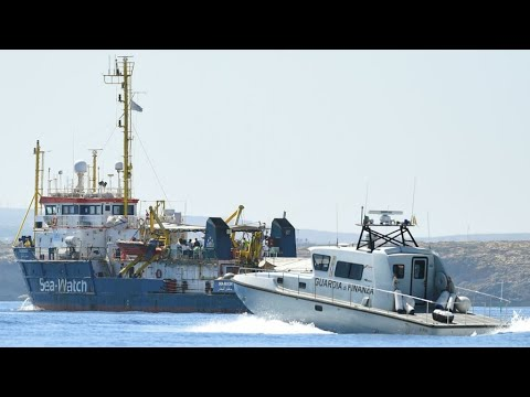 Migrant rescue boat reaches Lampedusa, defying Italy's orders to stay out