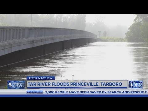 Flood waters spill around Edgecombe County dike, flow into Princeville