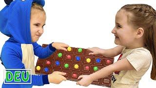Annie und die knifflige Schwester teilen sich Schokolade