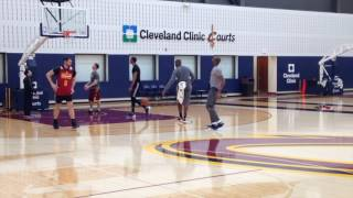 Cleveland Cavaliers' Kevin Love tests out his achy back during Wednesday's practice