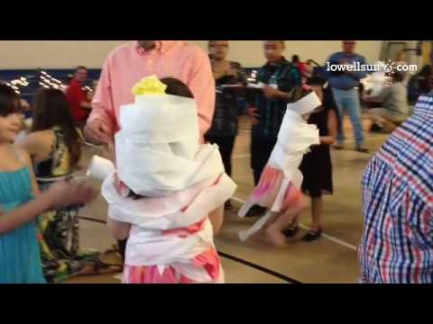 Toilet paper-wrapping contest at Pyne Arts Magnet School's Me & My Sweetheart Dance. #mummy @lowells