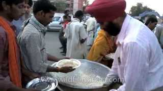 Serving free food to the poor, outside AIIMS in Delhi
