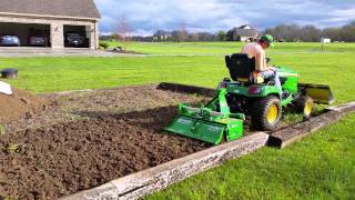 Tilling with John Deere X758 and Frontier 42