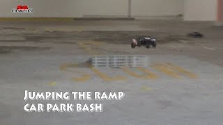 Offroad trucks bashing and jumping the ramps at the car park
