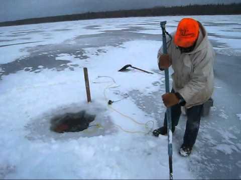 Winter Fishing With Nets On Delaronde Lake, Saskatchewan