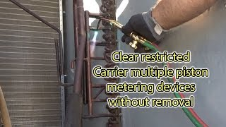 Trick for clearing Carrier multiple orifice manifolds in RTU