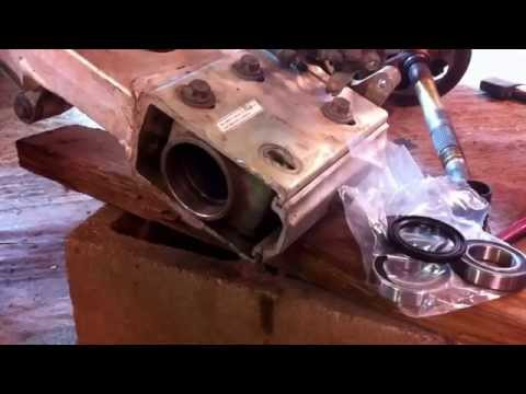 How to replace rear wheel bearings on a Suzuki LZT 400 PART 2. Putting it together