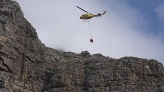 Bell helicopters try extinguish threatening Muizenberg wildfire
