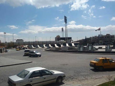 شاهد..  مسرحية للنظام وسط دمشق وكومبارس مضحك على شاشاته!- هنا سوريا