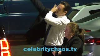 Hugh Jackman drops cell phone on the ground