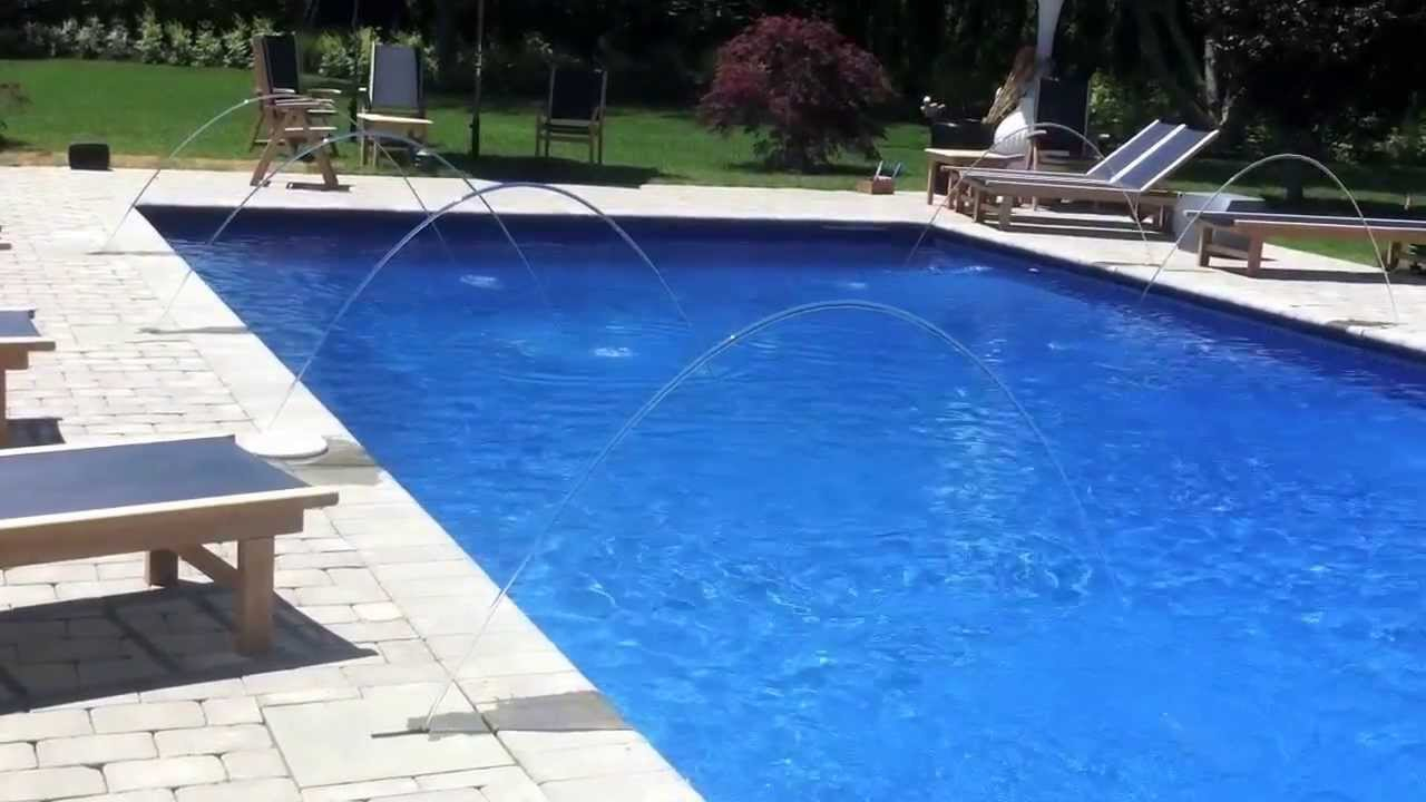Southampton Watermill swimming pool water features and color lighting by  Patricks Pools East Hampton