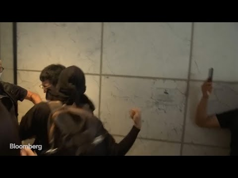 Watch Hong Kong Protesters Attack JPMorgan Banker