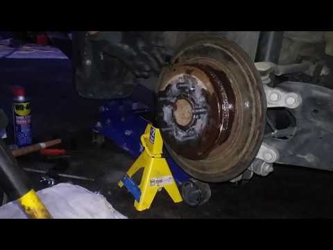 how to remove seized rusted Honda brake rotors in 2 minutes with sledge hammer DIY