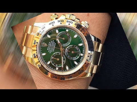 A brand new Rolex Cosmograph Daytona 116508 Green dial 40 mm yellow gold  Swiss luxury watch on wrist
