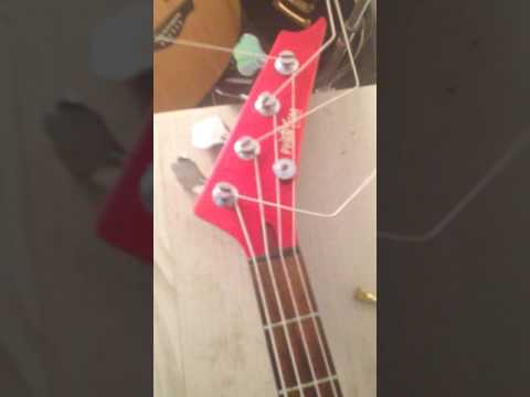 Phantom Guitars Bass in candy apple red 4 string