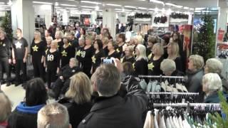 Rock Choir Flashmob M&S Worthing - Merry Christmas Everyone!