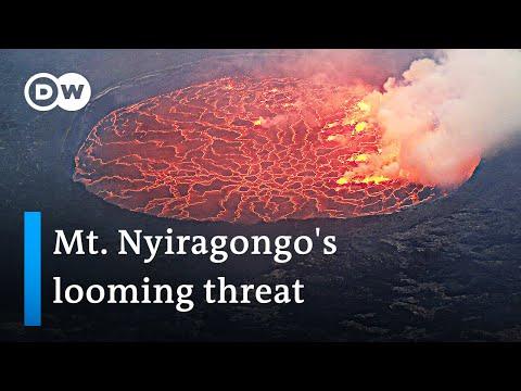 Thousands flee erupting