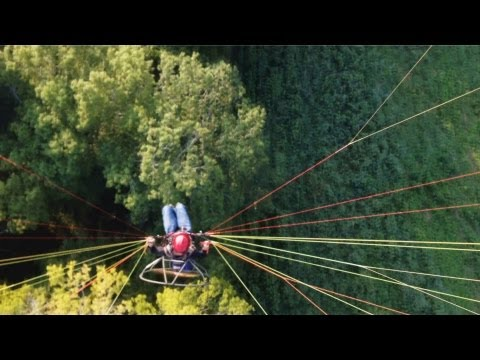 Solar Charged Electric Aircraft Flying Above the Trees - 1080 HD Sunny Paramotor