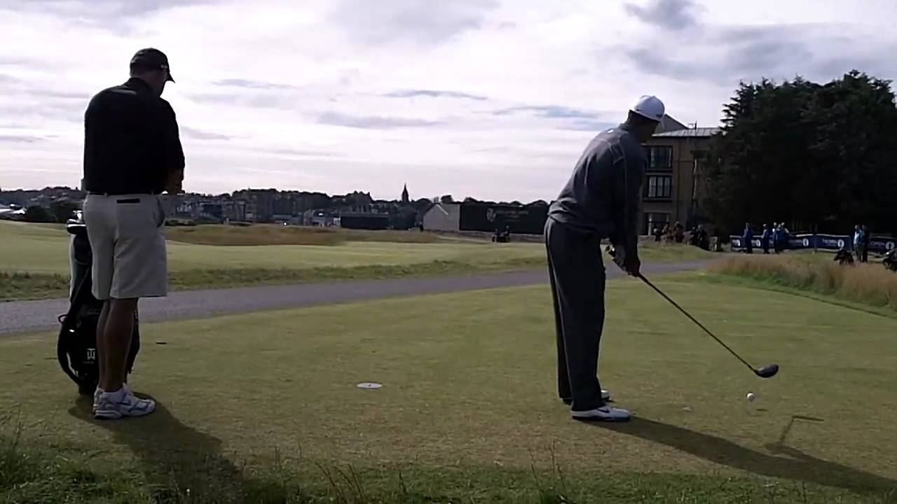 tiger woods hits 4 balls of the tee on the 17th at st