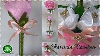 Caneta com ponteira de rosa no vasinho