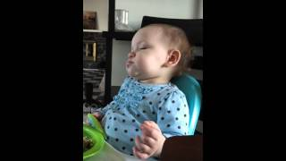 Adorable toddler in sleep eating euphoria!