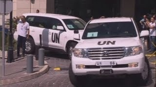 Snipers shoot at UN convoy at site of Syrian chemical attack