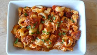 Red sauce pasta at home with fresh Tortellini.