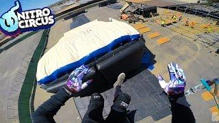 SCOOTER TRICKS ON NITRO CIRCUS MEGA RAMP AIRBAG!