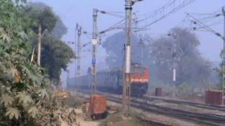 12875 Up Neelachal Express cruises past a LC at MPS !!