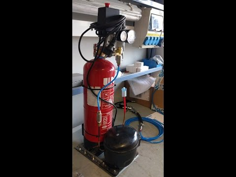 Como hacer un Compresor casero con un extintor y motor de frigorifico