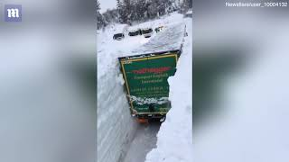 Trucks covered on Austrian road buried in 13ft of snow