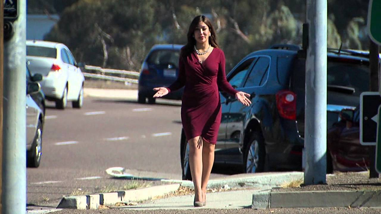 Car crash behind reporter during stand up
