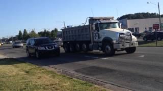International 5900 dump truck and Mack GU713 Granite dump truck