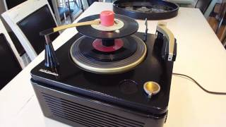 RCA record player playing a stack of 45 RPM records.