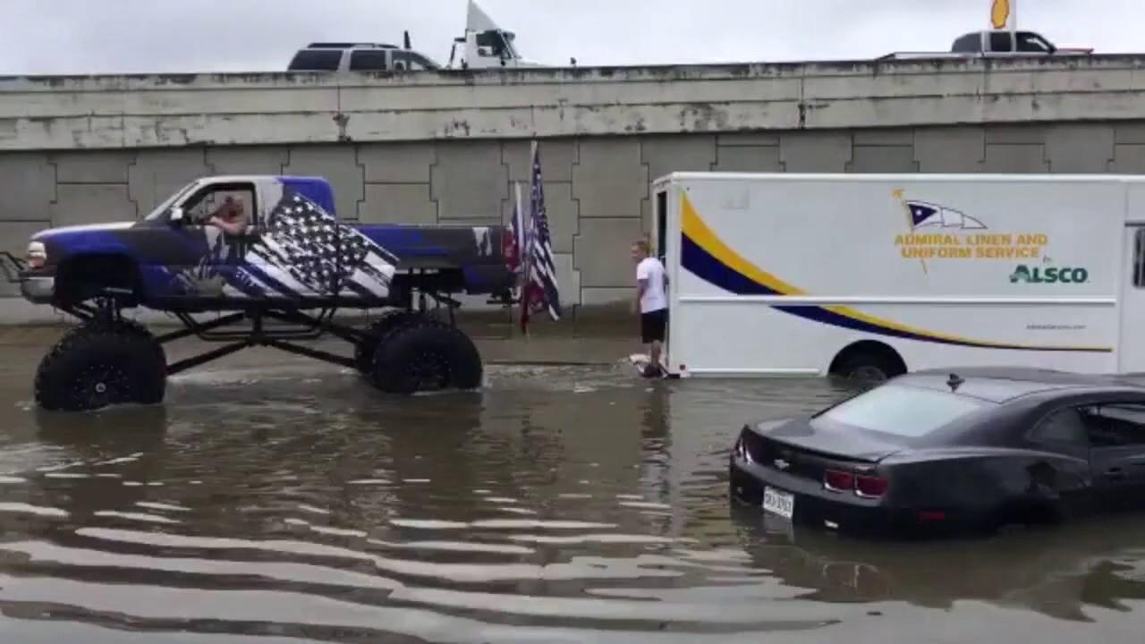 monster truck pulls vehicles from houston flooding youtube