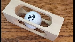 mystery golf ball in a block of wood woodlogger com