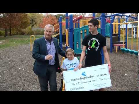 Bill Treasurer check presentation to Douglas Road Elementary School