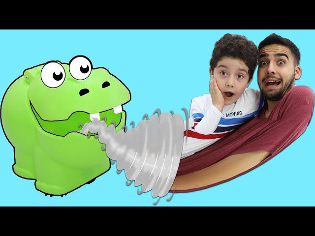 Yusuf and Uncle play with Monster Hippo