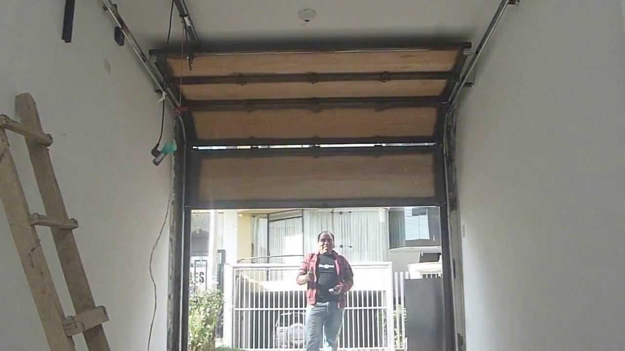 Puertas seccionales cusco puerta en for Puertas de fierro interiores