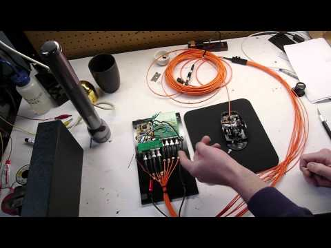 Fiberoptic mouse with quadrature encoders and custom shutter buttons