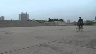 North korea documentary: Juche tower bicylce2 North Korea Pyonyang