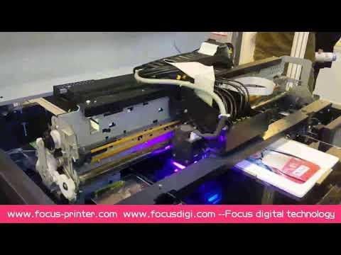 VOCANO JET PRO printing video on phone case on Exhibition