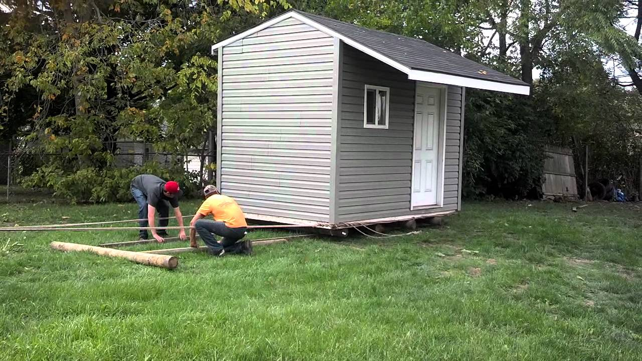 Moving a shed on fence post and landscape timbers - YouTube