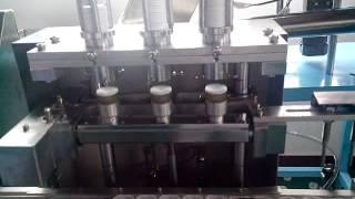 Three heads linear cap lining machine