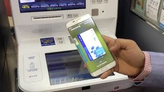 Use your phone as an ATM with Samsung Pay(Subscribe to CNET: http://bit.ly/17qqqCs Some ATMs in Korea are now compatible with Samsung's mobile payment system. We'll show you how easy it is to take ..., 2016-04-26T18:55:11.000Z)