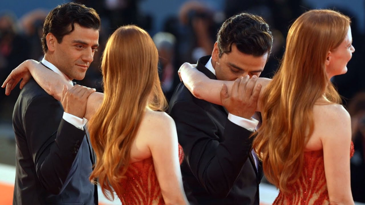 Download Oscar Isaac and Jessica Chatain's FLIRTY Red Carpet Moment