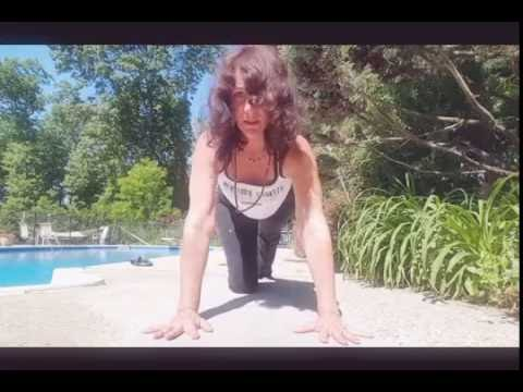Gentle Yoga practice by pool