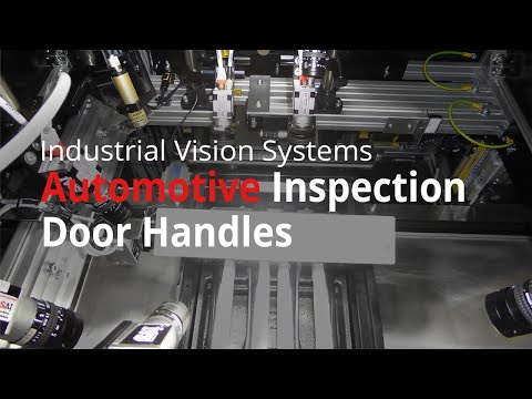 Machine vision system inspects automobile door handles