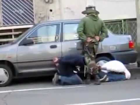 Basiji militia arresting protesters in Tehran - Iran 04 Dec 2009