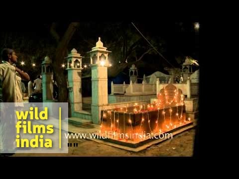 Graves illuminated with lights on the eve of Shab-e-barat